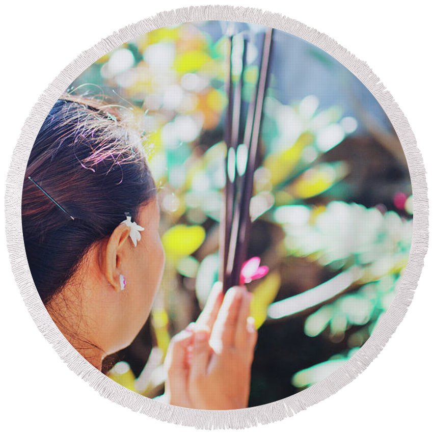 30's Round Beach Towel featuring the photograph Beautiful Asian Woman Holding Incense Sticks During Hindu Ceremony In Bali, Indonesia by Srdjan Kirtic