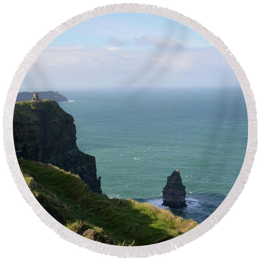 Cliffs-of-moher Round Beach Towel featuring the photograph Beautiful Rocky Towering Sea Cliffs Along The Cliff's Of Moher by DejaVu Designs