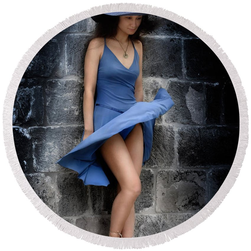 Romantic Round Beach Towel featuring the photograph Beautiful Romantic Woman Standing Near A Stone Wall by Maxim Images Prints