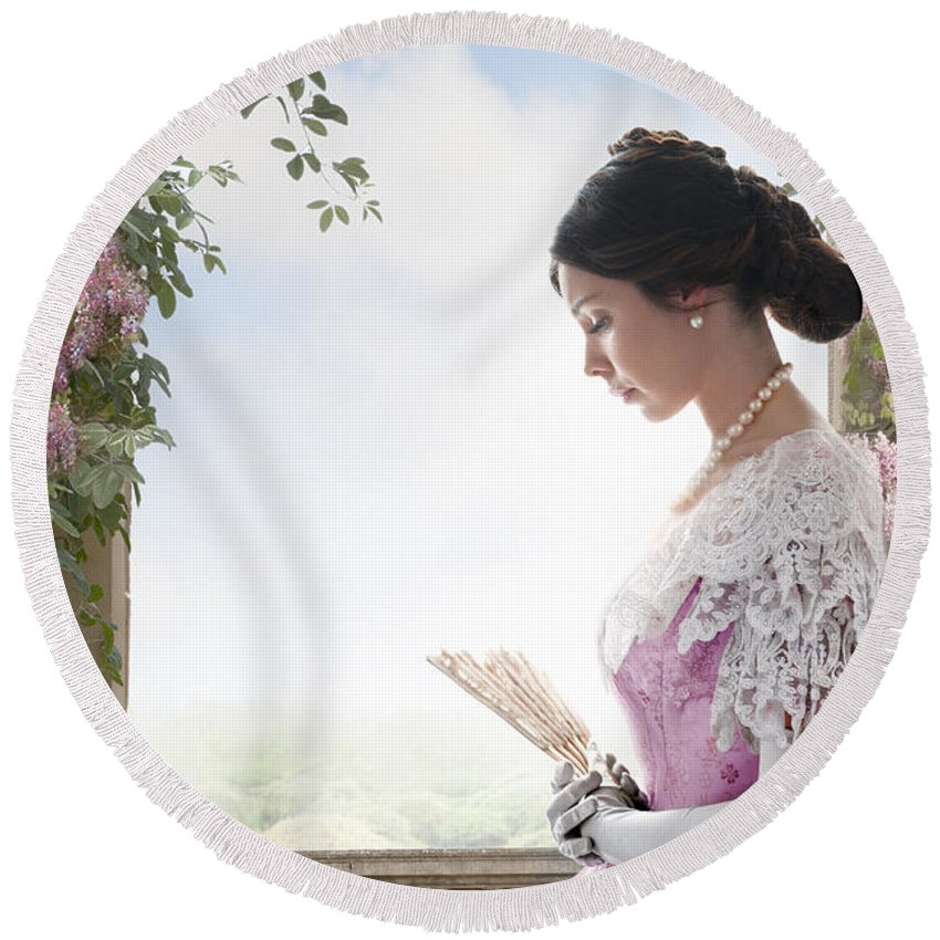 Victorian Round Beach Towel featuring the photograph Beautiful Victorian Woman In Pink Dress Standing Under A Wisteri by Lee Avison