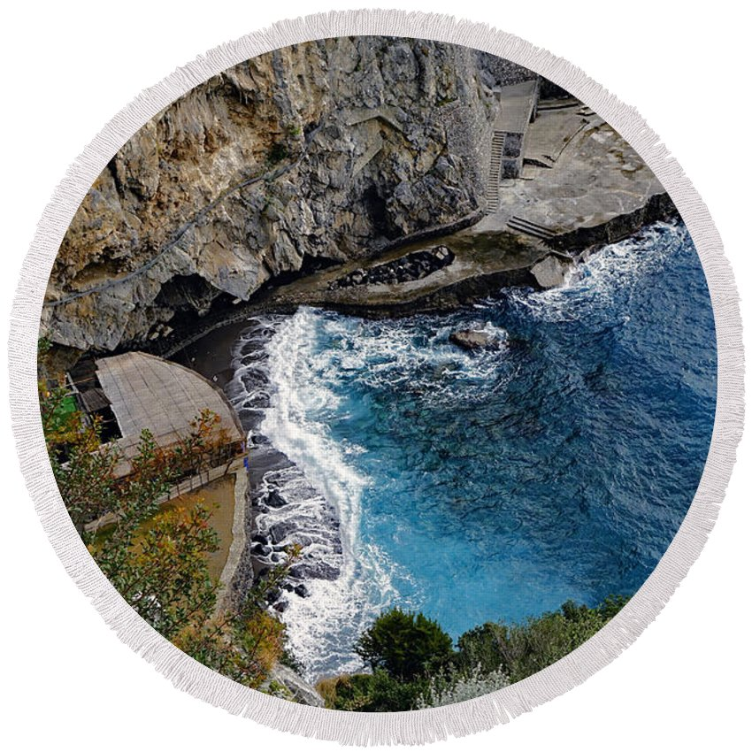 Amalfi Coast Round Beach Towel featuring the photograph Beautifully Carved Out Swimming Deck On The Edge Of The Sea On The Amalfi Coast In Italy by Richard Rosenshein