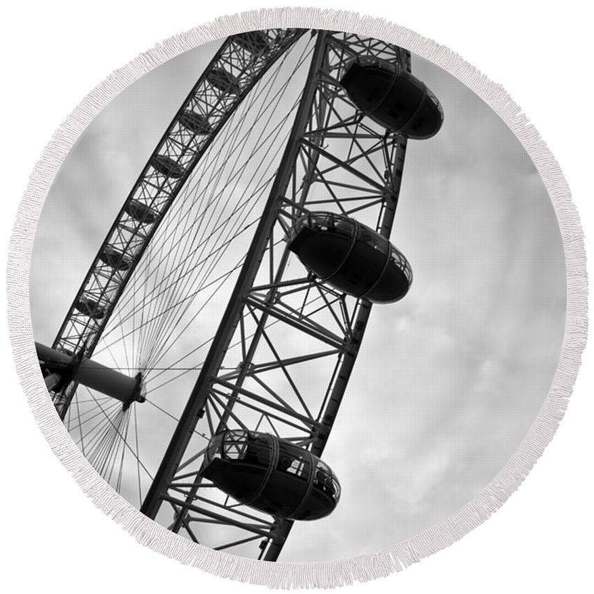 Below London's Eye Round Beach Towel featuring the photograph Below London's Eye Bw by Kamil Swiatek