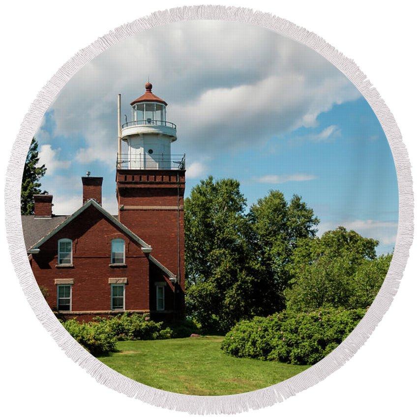 Big Bay Point Lighthouse Round Beach Towel featuring the photograph Big Bay Point Lighthouse by Phyllis Taylor