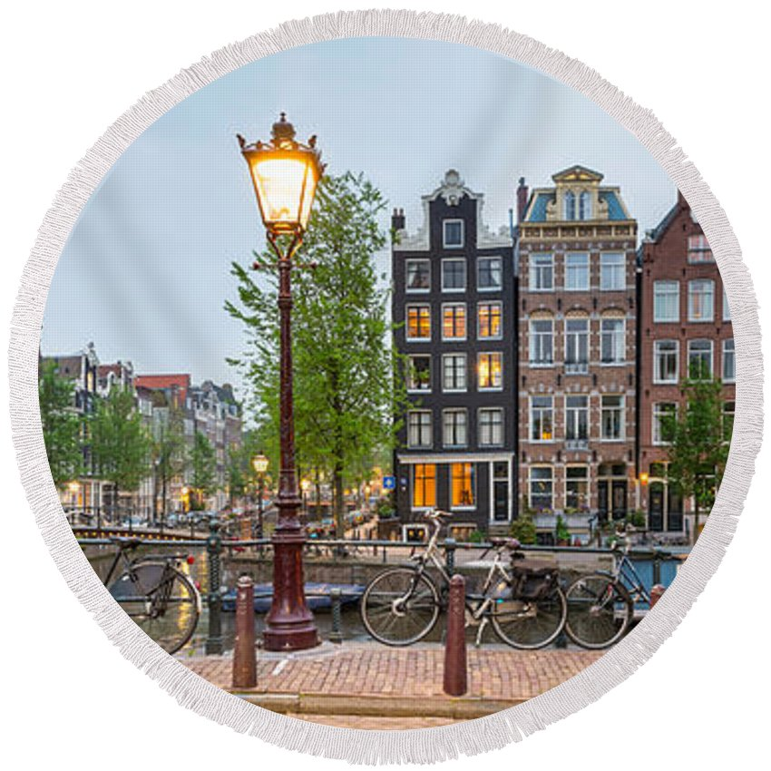 Photography Round Beach Towel featuring the photograph Bikes And Houses Along Canal At Dusk by Panoramic Images