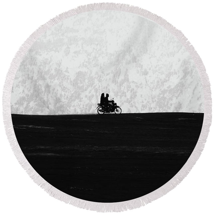 2 Round Beach Towel featuring the photograph Black And White Capture Of Two People Riding On The Motorbike In The Distance by Srdjan Kirtic