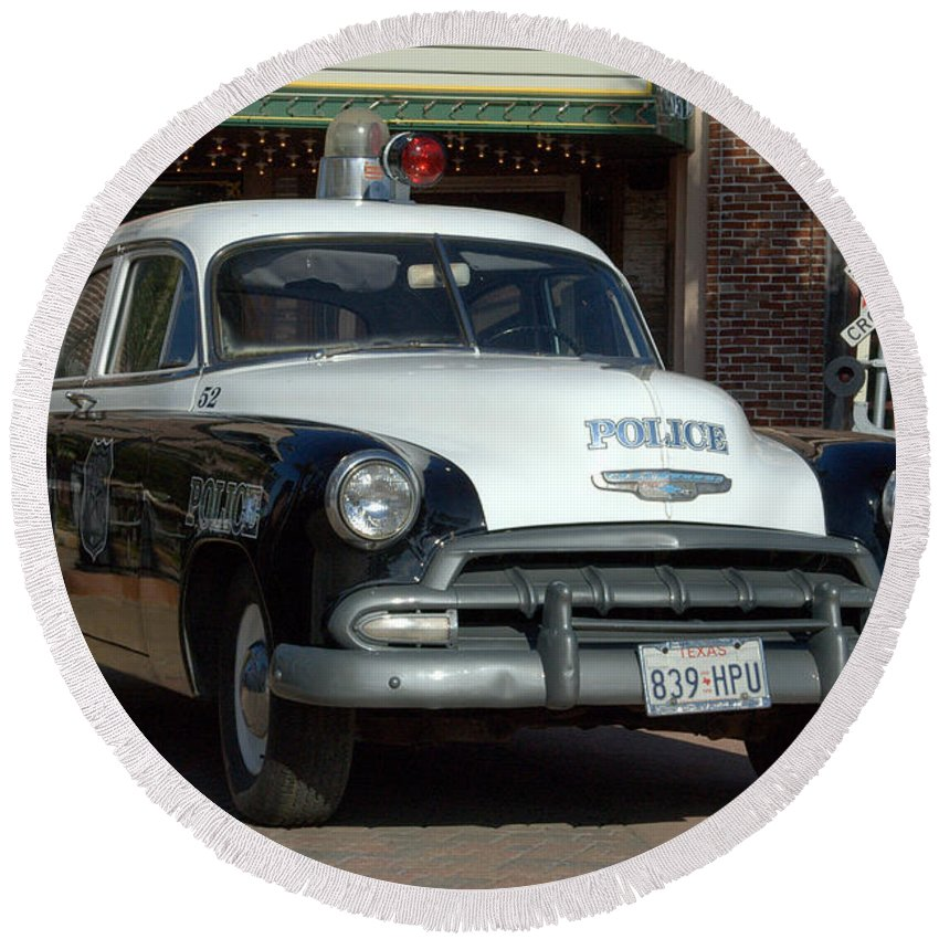 Vintage Police Car Round Beach Towel featuring the photograph Black And White In Color by Bernd Billmayer