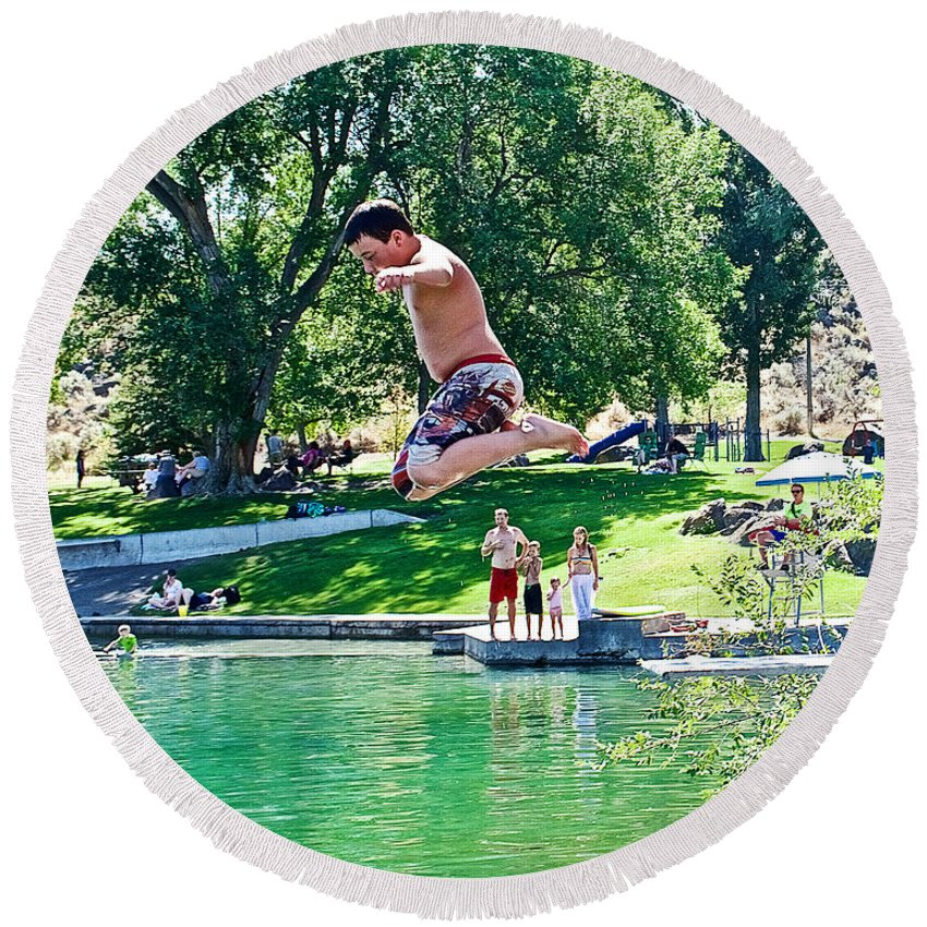 Boy Jumping Off The Board Into Dierkes Lake In Snake River Near Twin Falls Round Beach Towel featuring the photograph Boy Jumping Off The Board Into Dierkes Lake In Snake River Near Twin Falls-idaho  by Ruth Hager