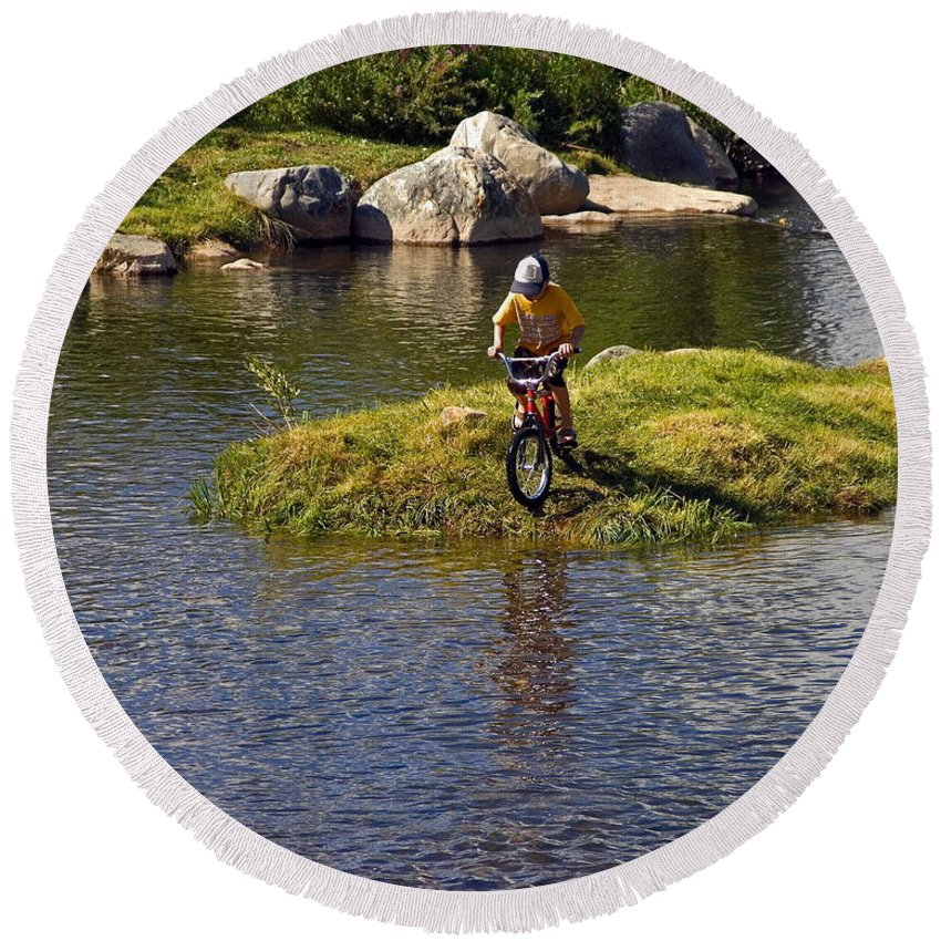 Boy Riding Bicycle Into River Round Beach Towel featuring the photograph Boy's Adventure by Sally Weigand