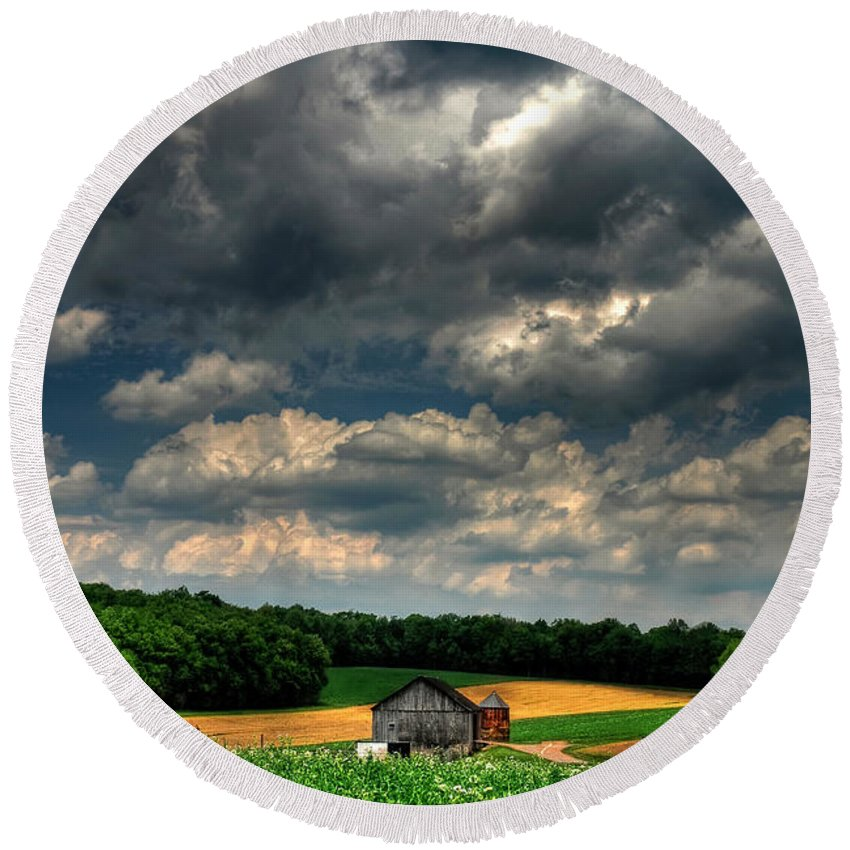 Old Barn Round Beach Towel featuring the photograph Brooding Sky by Lois Bryan