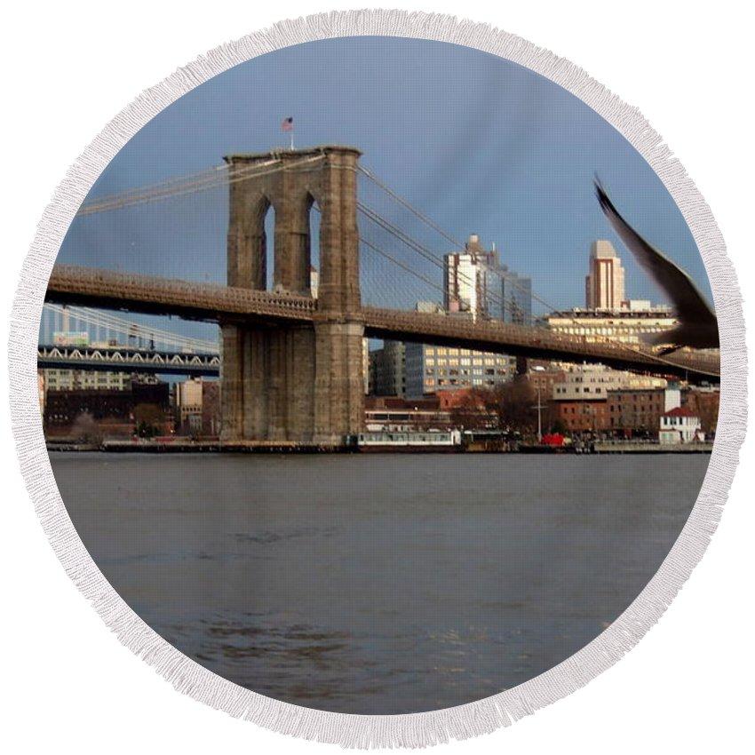 Brooklyn Bridge Round Beach Towel featuring the photograph Brooklyn Bridge And Bird In Flight by Anita Burgermeister