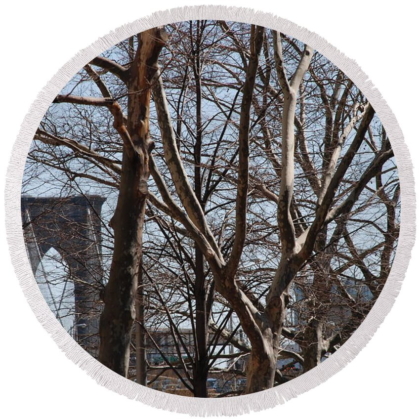 Architecture Round Beach Towel featuring the photograph Brooklyn Bridge Thru The Trees by Rob Hans
