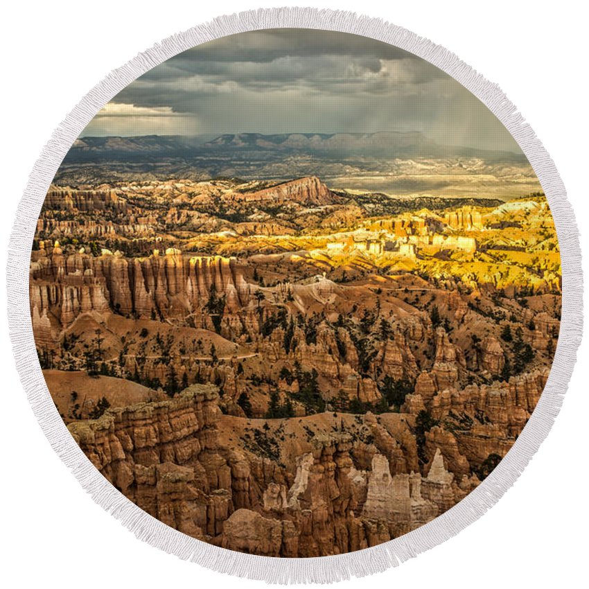 Bryce Canyon National Park Hoodoo Sandstone Rock Formation Southwest Utah Storm Desert Layers Cliffs Steep Walls Windows Round Beach Towel featuring the photograph Bryce At Sunset by Spencer Bawden