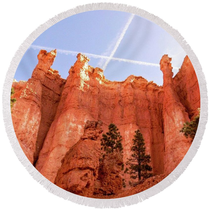 Bryce Canyon Round Beach Towel featuring the photograph Bryce Canyon Hoodoos With Contrails by Rincon Road Photography By Ben Petersen