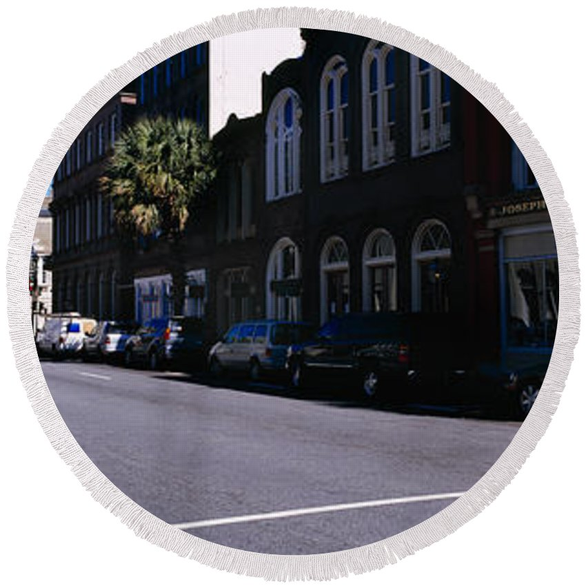 Photography Round Beach Towel featuring the photograph Buildings On Both Sides Of A Road by Panoramic Images