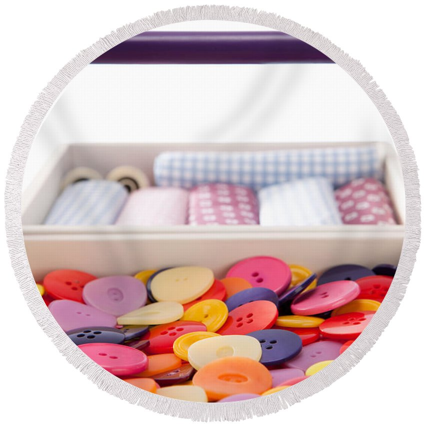 Sewing Box Round Beach Towel featuring the photograph Buttons And Textile Fabrics In A Sewing Box by Wolfgang Steiner