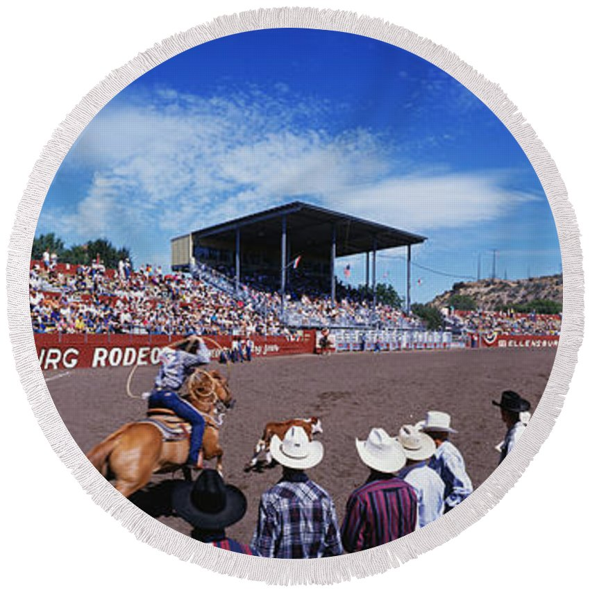 Photography Round Beach Towel featuring the photograph Calf Roping Event At Ellensburg Rodeo by Panoramic Images