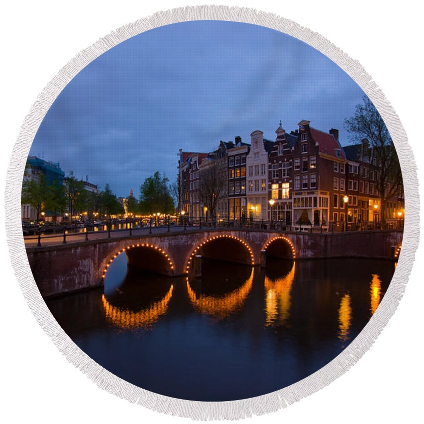 Amsterdam Round Beach Towel featuring the photograph Canals Of Amsterdam At Night by Anastasy Yarmolovich