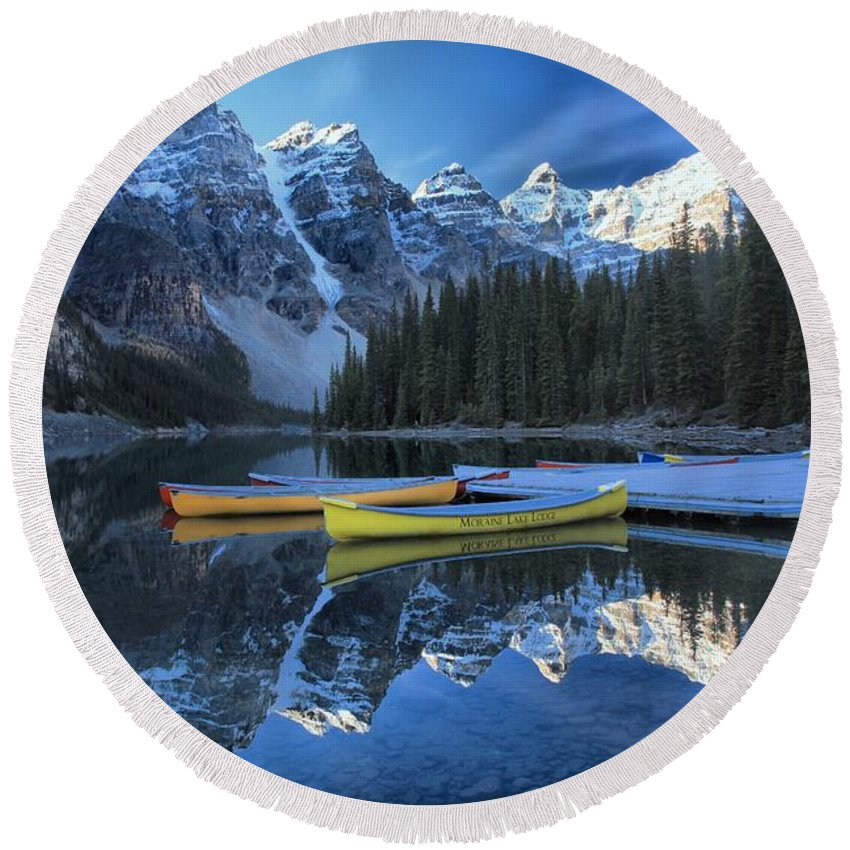 Moraine Lake Round Beach Towel featuring the photograph Canoes Under The Peaks by Adam Jewell