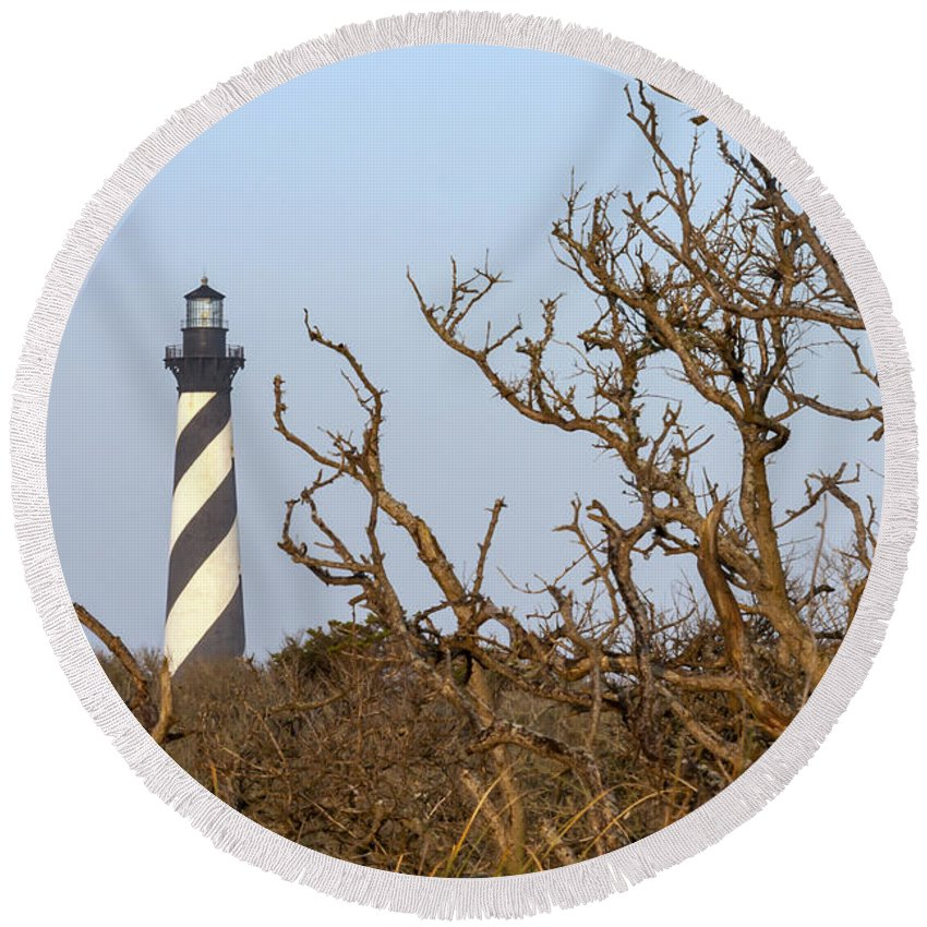 Architecture Round Beach Towel featuring the photograph Cape Hatteras Lighthouse Through The Brush by Liza Eckardt
