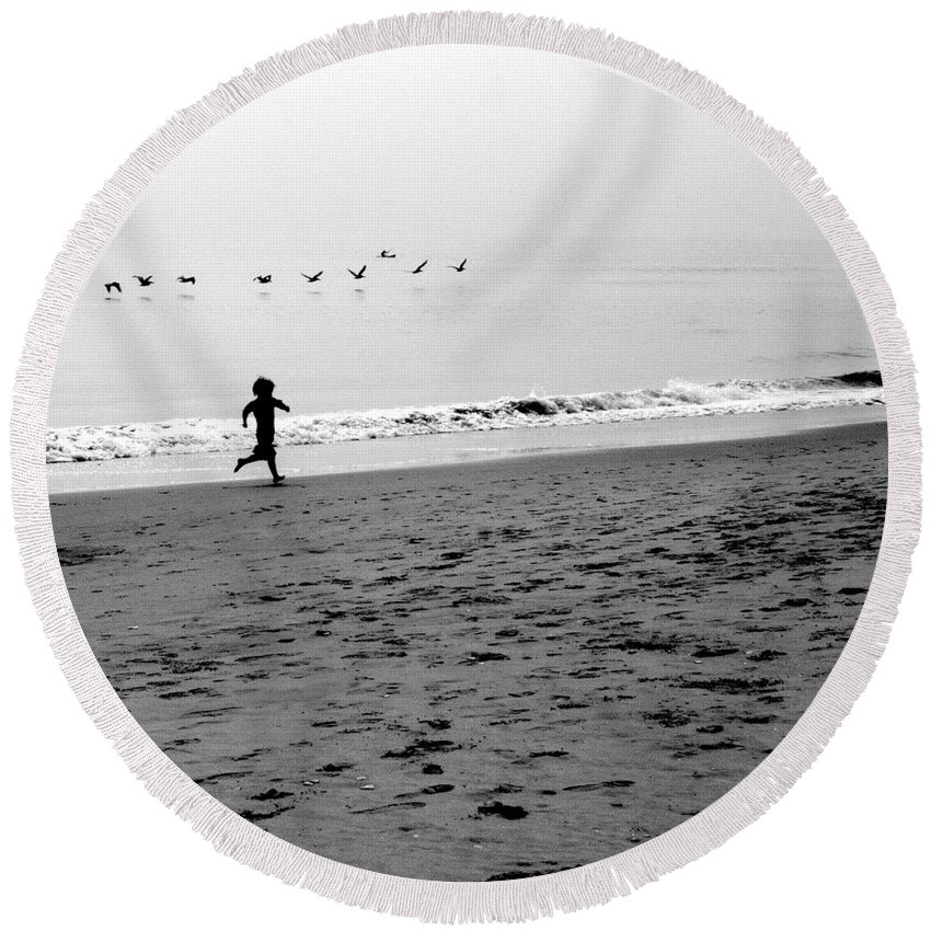 Photograph Round Beach Towel featuring the photograph Carefree by Jean Macaluso