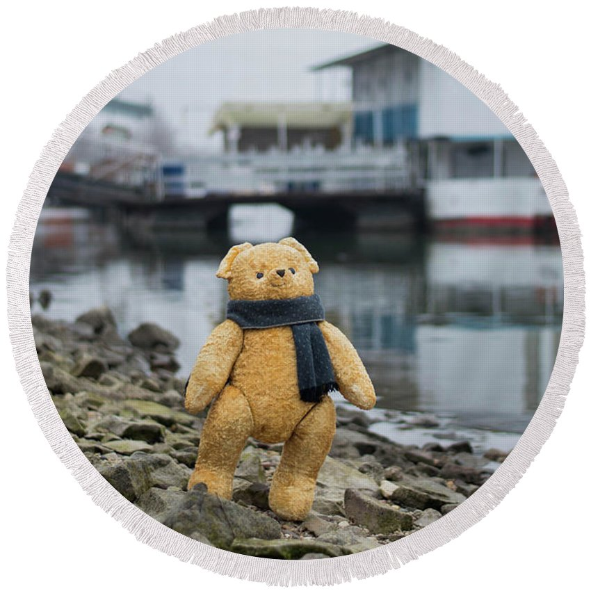 Animal Round Beach Towel featuring the photograph Cheerful Teddy Bear In Knitted Scarf Stand By The Riverside Beside The Port by Andrea Varga