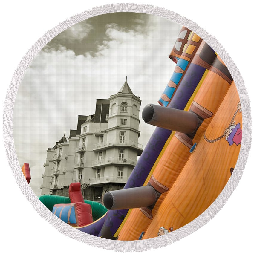 Childrens Round Beach Towel featuring the photograph Childrens Play Areas Contrast With The Victorian Elegance Of The Grand Hotel In Llandudno Wales Uk by Mal Bray