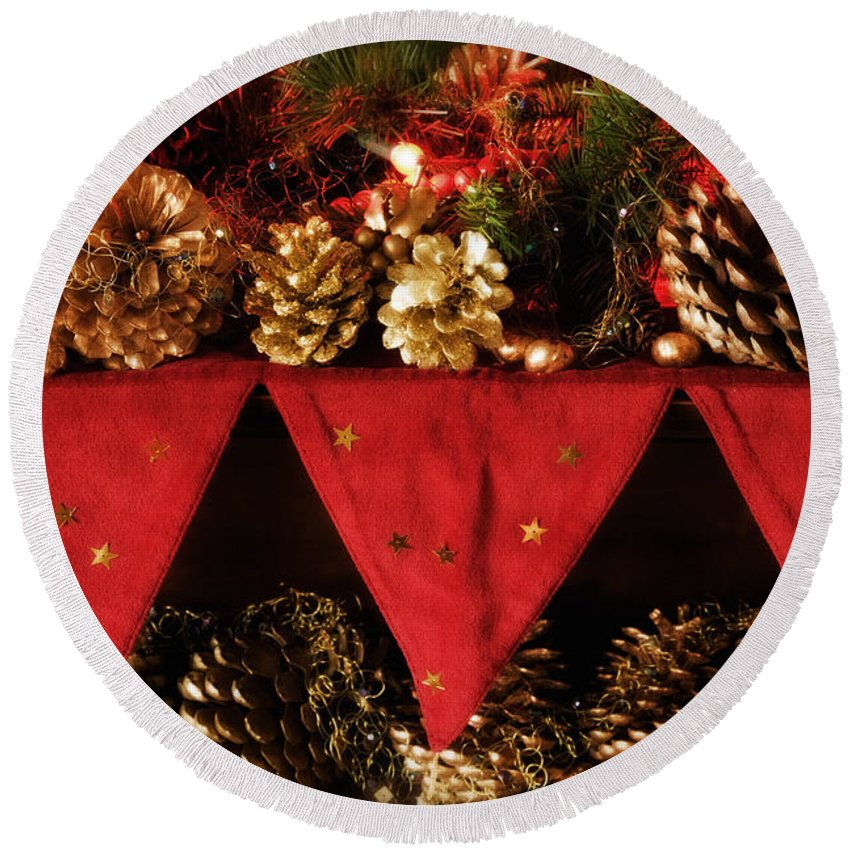 Christmas Round Beach Towel featuring the photograph Christmas Decorations Of Garlands And Pine Cones by Mal Bray