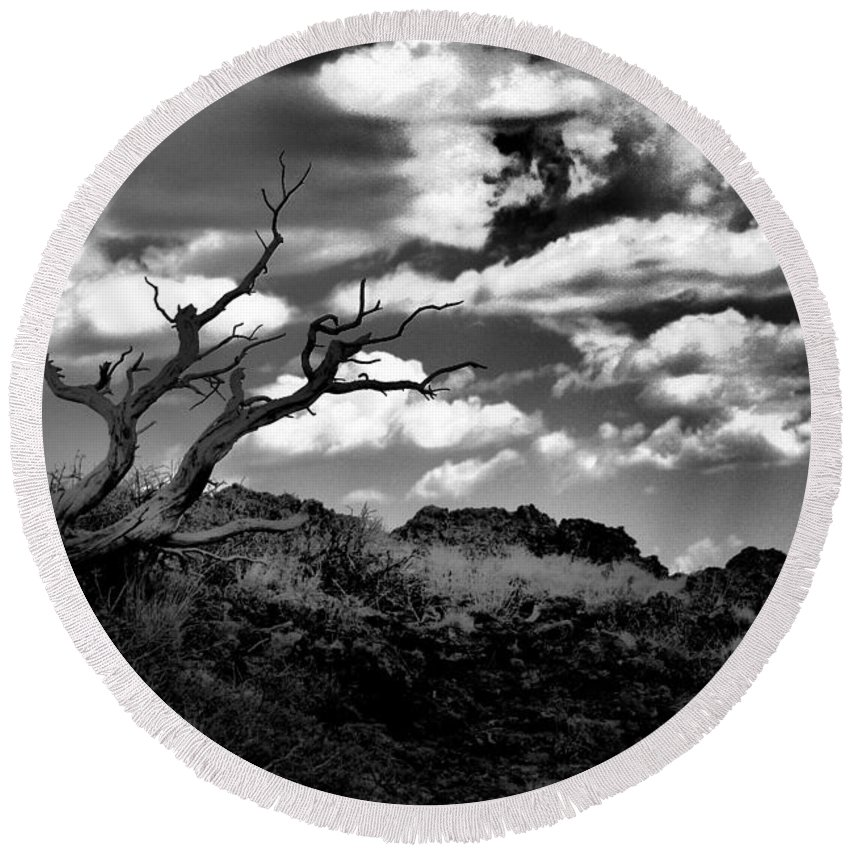 Black And White Round Beach Towel featuring the photograph Clouds and a tree BaW by Jeff Swan