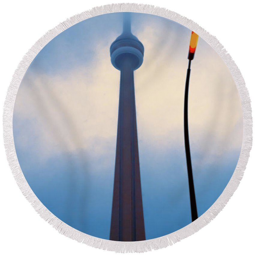 America Round Beach Towel featuring the photograph Cn Tower In Toronto With Red Streetlamp by Hans Schrodter