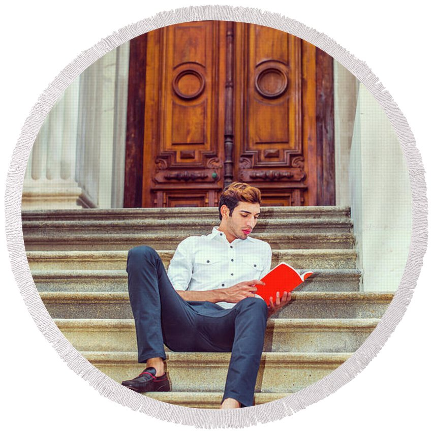Young Round Beach Towel featuring the photograph College Student Reading Red Book, Sitting On Stairs, Relaxing Ou by Alexander Image