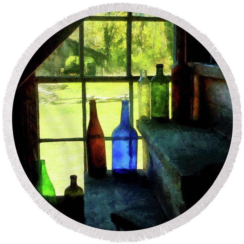 Bottles Round Beach Towel featuring the photograph Colored Bottles On Steps by Susan Savad
