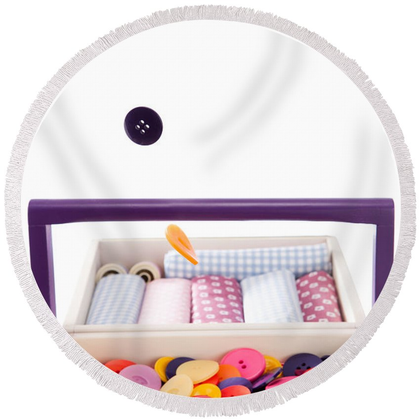 Falling Round Beach Towel featuring the photograph Colorful Buttons Fall Into A Sewing Box by Wolfgang Steiner