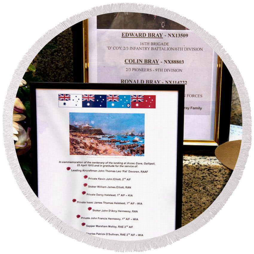 Few Faces Of People Who Died During A War Defending Our Freedom On Martin Place War Memorial In Sydney. Round Beach Towel featuring the photograph Commemorations Anzac Cove by Miroslava Jurcik