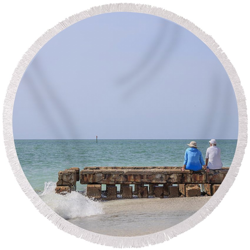 Jetty Round Beach Towel featuring the photograph Couple Sitting On An Old Jetty Siesta Key Beach Florida by Edward Fielding
