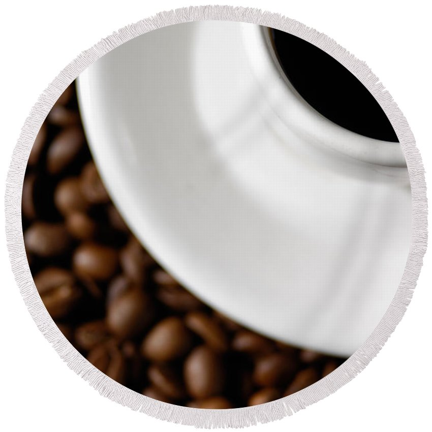 Cup Round Beach Towel featuring the photograph Cup Of Black Coffee On Coffee Beans by Maxim Images Prints