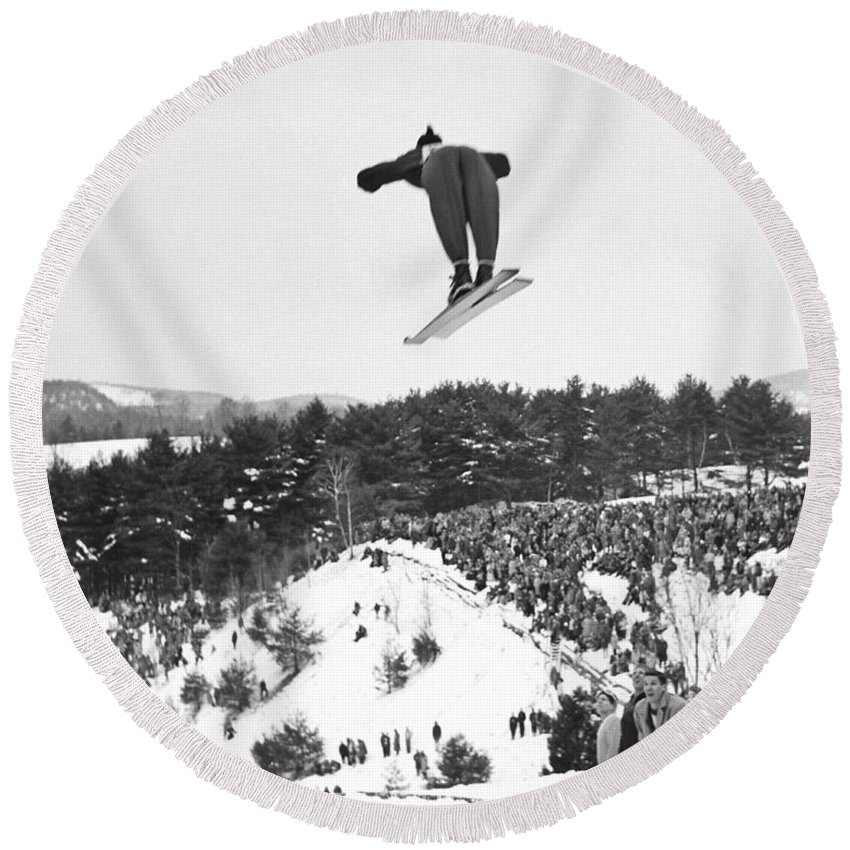 1950's Round Beach Towel featuring the photograph Dartmouth Carnival Ski Jumper by Underwood Archives
