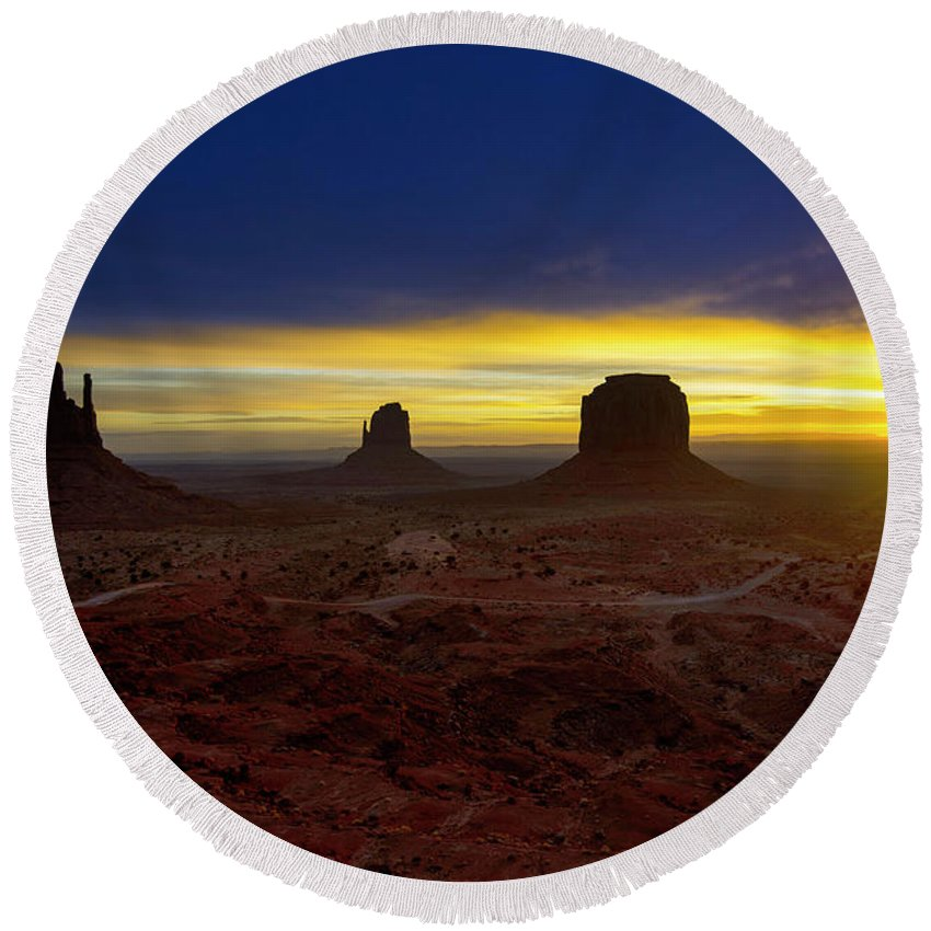 Monument Valley Round Beach Towel featuring the photograph Dawn In The Valley by Wayne Dion
