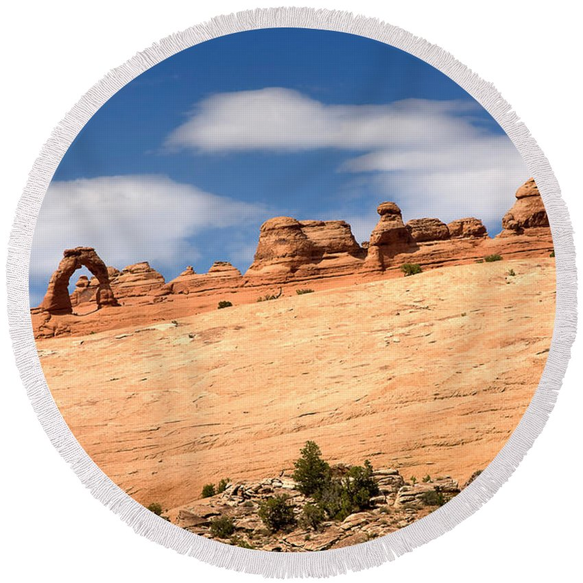 Travel Round Beach Towel featuring the photograph Delicate Arch Famous Landmark In Arches National Park Utah by Louise Heusinkveld