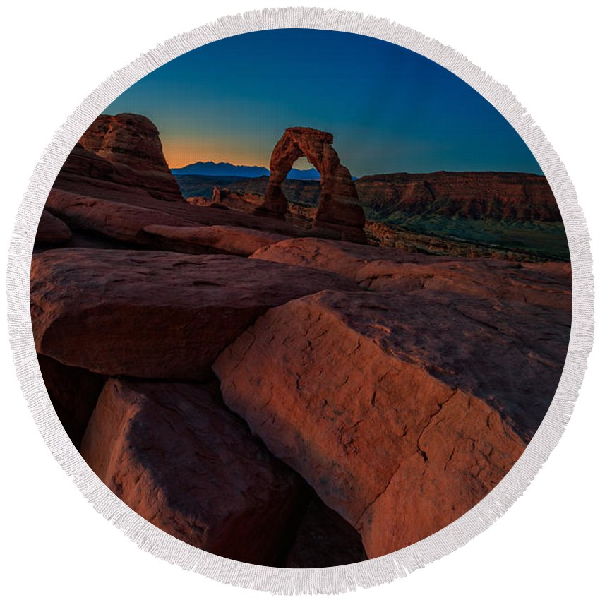 Delicate Arch Round Beach Towel featuring the photograph Delicate Dawn by Rick Berk