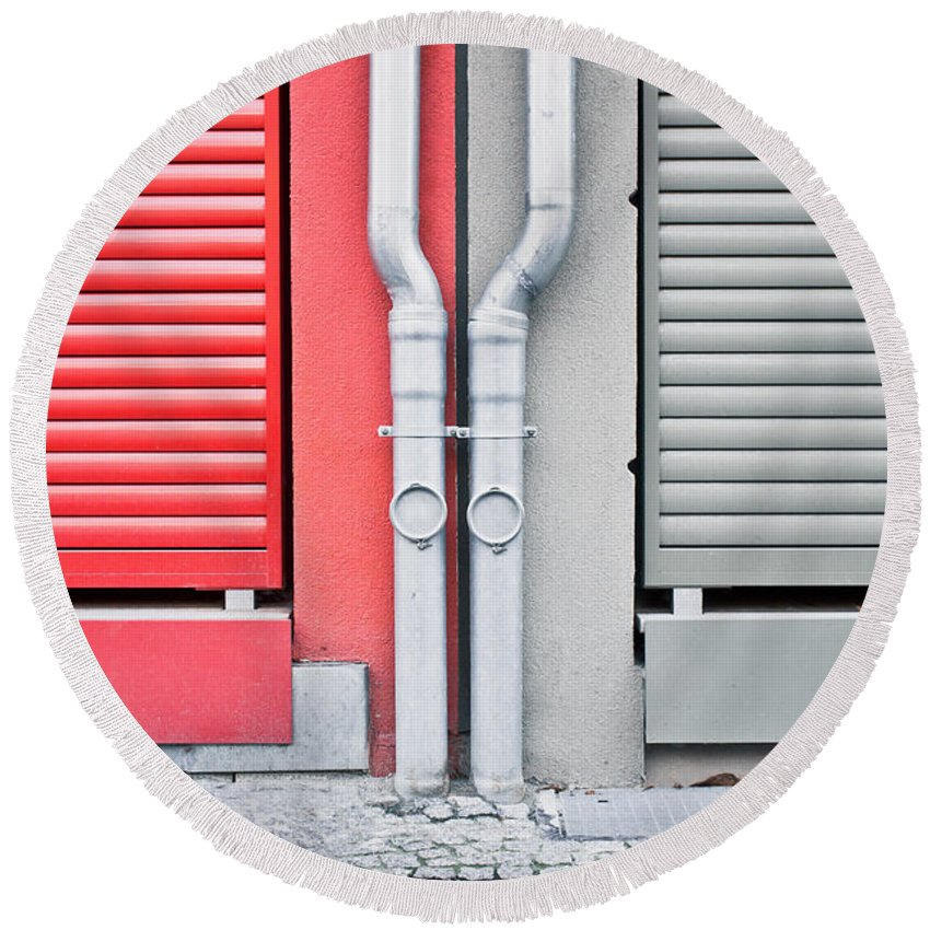 Abstract Round Beach Towel featuring the photograph Drain Pipes by Tom Gowanlock