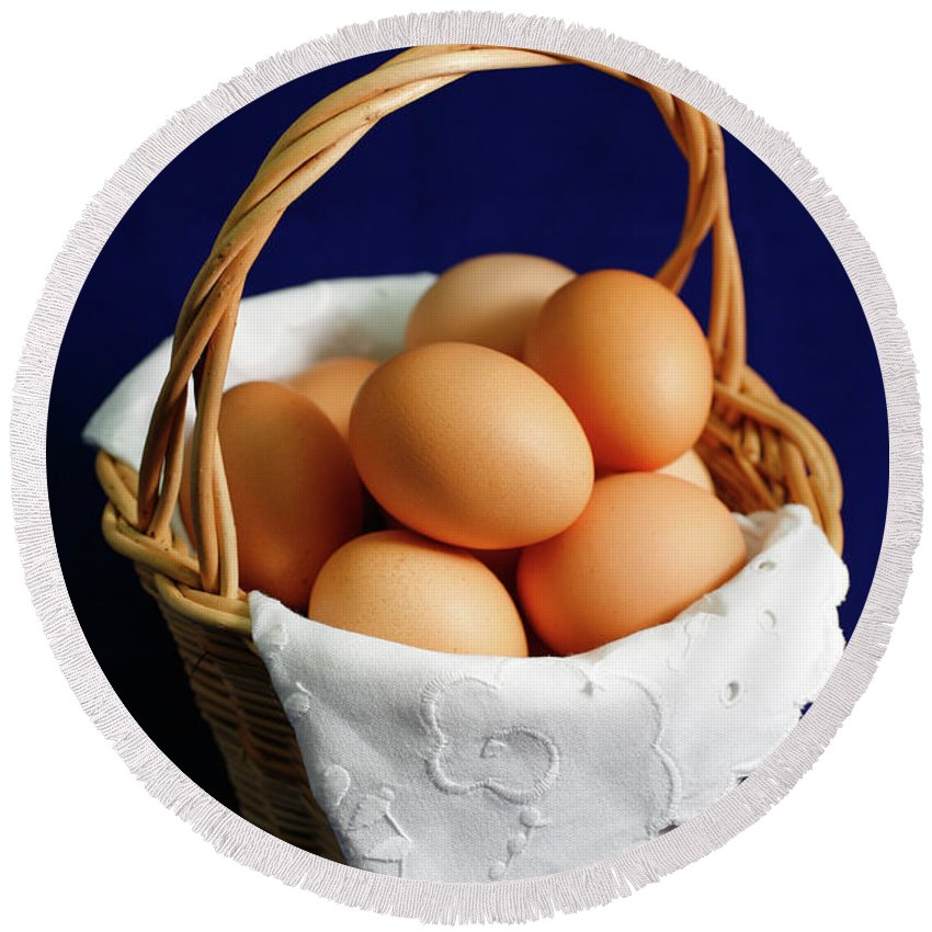 Eggs Round Beach Towel featuring the photograph Eggs In A Wicker Basket. by Gaspar Avila