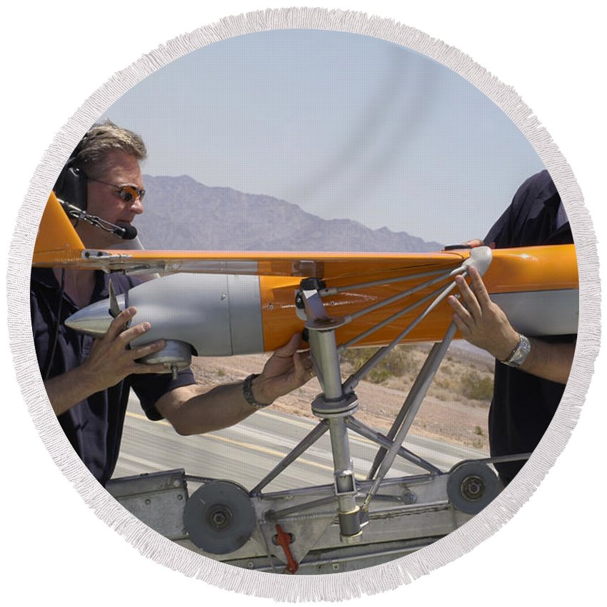 Boeing Round Beach Towel featuring the photograph Engineers Mount A Scaneagle Unmanned by Stocktrek Images