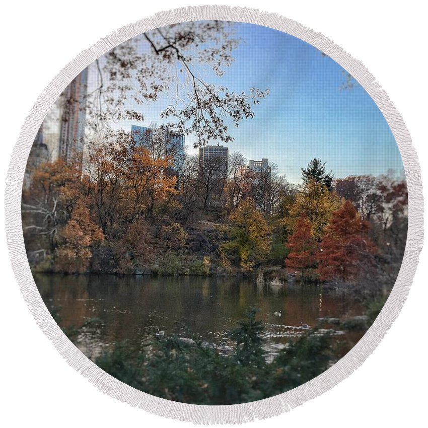 New York City Buildings Concrete Jungle Pond Trees Central Park Fall Colors Round Beach Towel featuring the photograph Evening In Central Park by Brandon Stevens