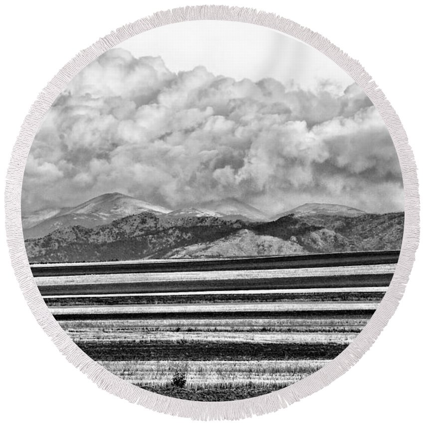 Black And White Round Beach Towel featuring the photograph Farm Fields Meet The Rocky Mountains by James BO Insogna