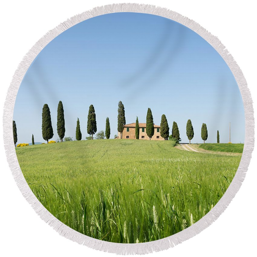 Farmhouse Round Beach Towel featuring the photograph Farmhouse With Cypress Trees And Crops In Tuscany by IPics Photography