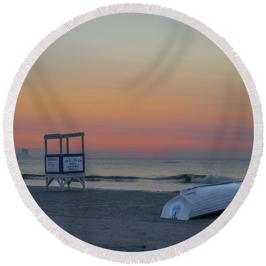 d3146814c423f First Round Beach Towel featuring the photograph First Light On Ocean City  New Jersey Beach by