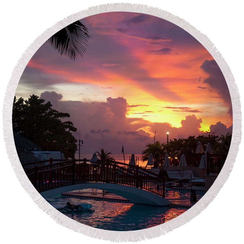 Jamaica Round Beach Towel featuring the photograph First Sunset In Negril by Dennis Ludlow