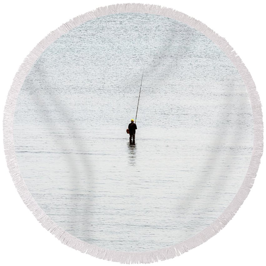 Fisherman Round Beach Towel featuring the photograph Fisherman by Miguel Gomez
