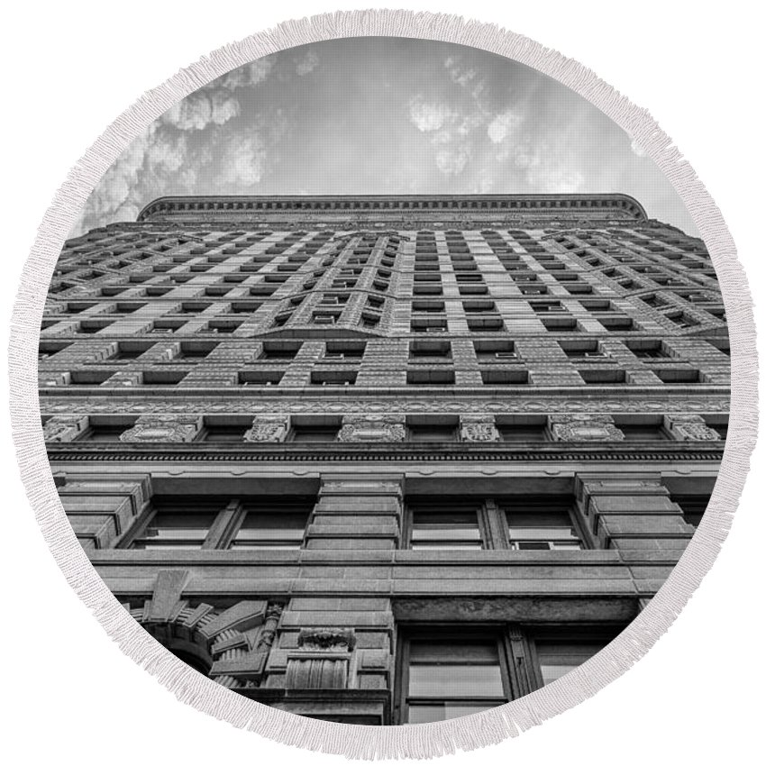 Flatiron Building Round Beach Towel featuring the photograph Flatiron Building Sky Black And White by Alissa Beth Photography