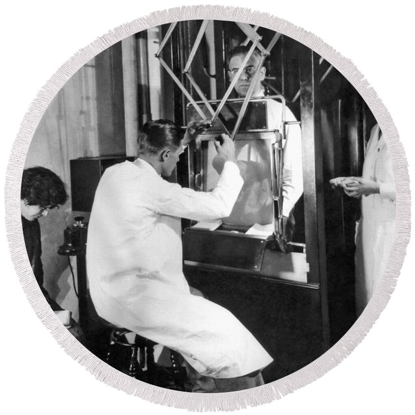 1920s Round Beach Towel featuring the photograph Floroscope Examination by Underwood Archives